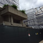 The planters at Unity Temple's west entrance are among the only exterior surfaces still visible from the street.