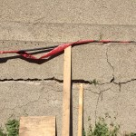 Crack in the concrete that will be repaired during construction.