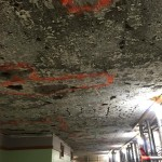 All plaster on the Unity Temple ceilings have been removed. This has allowed for visual inspection and sounding of repairs that are needed to the Unity House concrete ceiling and roof. Once ceiling and roof repairs are complete, plaster will be placed back onto the ceiling.